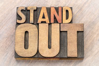 stand out word abstract in wood type