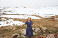 Happy woman having fun in the winter landscape