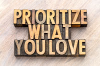 prioritize what you love word abstract in wood type