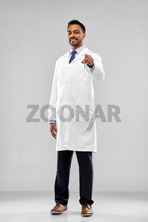 smiling indian doctor or scientist pointing to you