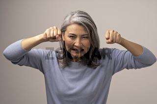 Evil Adult Mongolian Woman with Gray Hair.