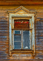 Wooden window carved frame of wooden lacy in Astrakhan Russia