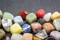 colorful gemstones on slate stone