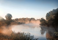 Early foggy morning and a small river.