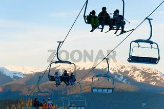Skiers ski lift mountains resort