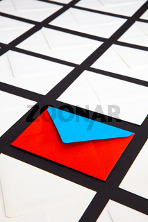 Composition with white and two-color envelopes on the table.