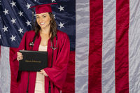 Beautiful Brunette Model Posing With A Diploma With An American Flag In The Background