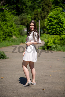 Beautiful smiling woman in summer park