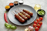 Barbecued turkey kebab decorated with fresh onion