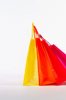 Set of colorful empty shopping bags isolated on the white background.