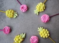 Cool sweet meringues in the pineapple and roses form