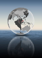 Malaysia on translucent globe above water