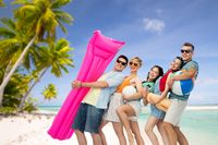 friends with beach supplies over exotic landscape