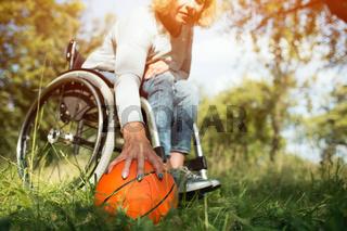 Basket ball is laying near wheelchair