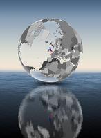 United Kingdom on translucent globe above water