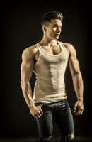 Handsome young muscular man in studio shot