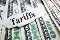Tariffs newspaper headline on money