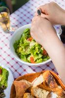 Female serving green summer salad