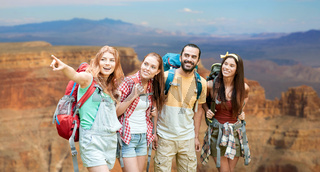 group of friends with backpacks at grand canyon
