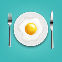 Plate With Fried Eggs Fork And Knife With Mint Cloth
