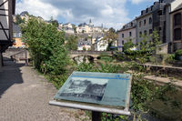 Downtown Luxembourg city Grund with information panel along Alzette river