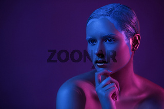Nude Young Model with Creative Make Up on Dark Background in Blue Neon Light.