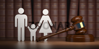 Family law. Gavel and shapes of men, women and child with books.