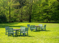 Outdoor table and chairs on lawn in large garden