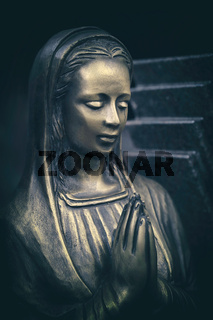 praying bronze maria tomb statue