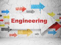 Building construction concept: arrow with Engineering on grunge wall background