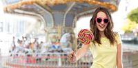 teenage girl in sunglasses with lollipop