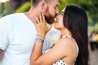 Handsome guy and beautiful girls kissing in the park