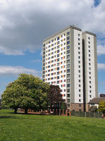 holbeck moor in leeds with with spring trees surrounded by housing on and a large public housing tower block meynell heights built in 1966 for leeds council