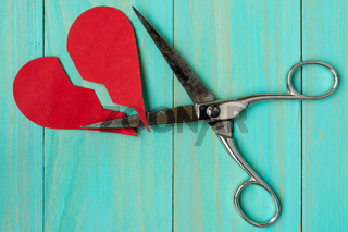 Paper red heart cuted by scissors