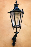 old street lamp on yellow wall