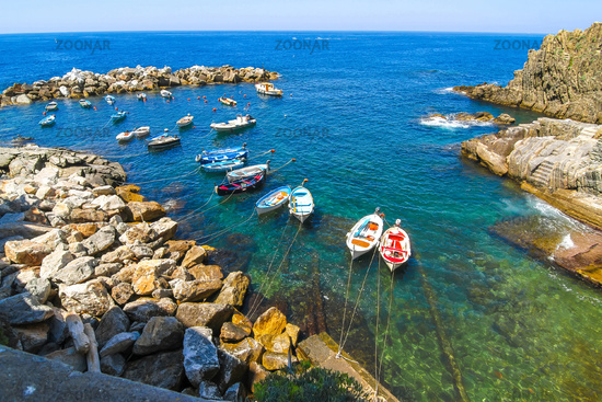 Fishing boats floating in the harbour of Cinque Terre