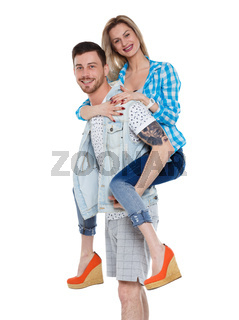 Front view of a stylish couple. beautiful friendly girl and guy together.