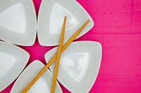 Ceramic bowls  and bamboo chopsticks for sushi food.