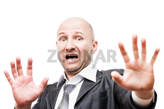Scared or terrified businessman hand gesturing hide face stop sign