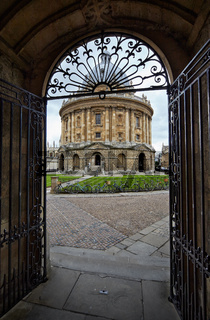 The view of Radcliffe Camera through the gate of University church. Oxford University. England.