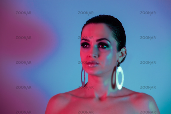 Fashion model under the neon pink and blue light
