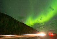 The Northern Lights Shine As Travelers Pull Over to Look UP