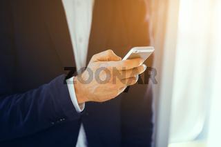 Man using smartphone in subway train.