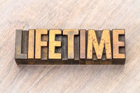 lifetime - word abstract in wood type