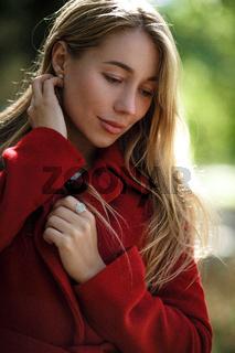 Young woman walking wearing red coat