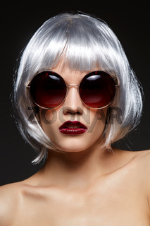 girl in silver wig and round sunglasses