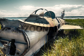 war plane crashed on shore of sea several years ago and lies on dunes