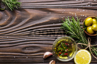 Flat lay food background made of oils condiments and spices on kitchen table. Cooking concept