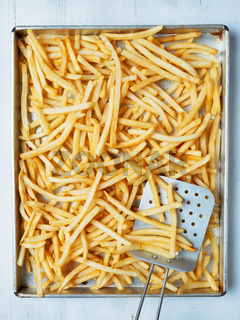 tray of rustic golden french fries