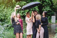six girls with an umbrella